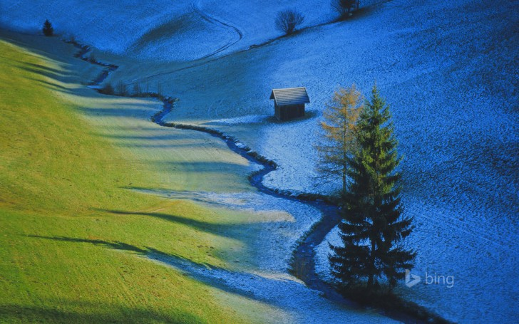 Sun defrosts half a meadow in Tulfes, Austria